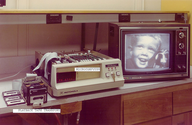 Kodak's first digital camera reproducing a photo.